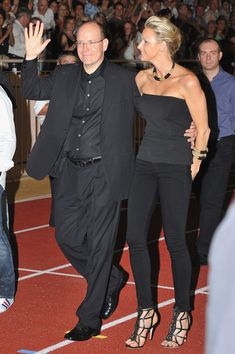 Prince Albert II and Princess Charlene of Monaco. What can you say about this look? All in black in the middle of summer.. can't imagine Princess Grace or Ranier in a get up like this. Way too fetish for Royal, or even Serene highnesses