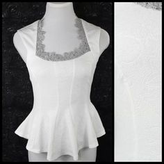 """Victorian White Lace Metallic Textured Top Small Lace Neck Blouse  Size  Small   BEAUTIFUL!!!!   Floral textured fabric adorned with metallic silver lace.  96% polyester & 4% spandex. Lots and lots of stretch to this top for a perfect and comfortable fit.  Please check my closet for many more items including scarves and jewelry.  All measurements are taken with garment laying flat.    Armpit to armpit up to 36""""  Waist up to 34""""  Length of garment 24"""" Flamingo Tops"""