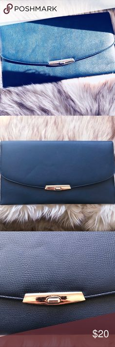 Dark blue clutch purse NWOT beautiful dark blue color purse that has goldtone hardware (turn lock) and attached chain. There is damage to the inside left, as photographed, which doesn't allow the bag to be converted into a shoulder bag anymore, but the defect isn't seen from the exterior and the purse still functions as a clutch. Clean interior, never used! Bags Clutches & Wristlets
