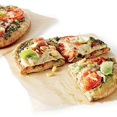 Pita Pizzas with Kale Pesto, Tomatoes, and Bacon | CookingLight.com and MyRecipes.com (375 calories per serving) -- Looks nummy!