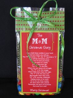 "If you hold these candies in your hand and turn them, you will see... The ""M"" becomes a ""W"", then an ""E"" and  a ""3"". They tell the Christmas story...  Cute to give to neighbors, your primary class, young womens class, or just to get for yourself to read to your kids for a Christmas Story. pioneerpartyandgift.com"