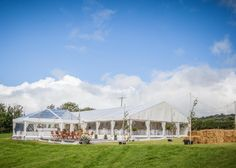 Wedding marquee with clear roof reception bubble, decked area and lots of outdoor lighting. All built on integral wooden flooring to level the slope of the site.