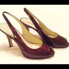 Anne Klein Burgandy Slingback Peep Toe Pumps 7.5 Size 7.5 Anne Klein burgundy patent leather heels.   Tops are immaculate and soles show normal wear from walking. 3 inch heels and elastic stretch on slingback rather than buckle. The color is a deep burgundy that looks lovely with black, tan, navy, cream, and white. Anne Klein Shoes Heels