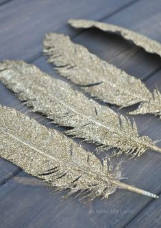 Gold Glittered Feathers. So Cute!