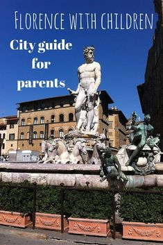 One of the best things to do in Florence with kids is to take a stroll in the city's beautiful city centre: this is piazza della signoria and the statue of the Neptune with the backdrop of Florence clear deep blue sky