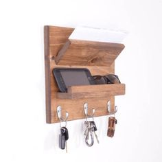 This listing is for a handmade wall mount organizer for your jackets, mail and keys. It features a pouch for mail and two shelves for sunglasses, wallets, gloves, cell phones or any other small items you can throw at it. Unlike some of our competitors who use just nails or screws we