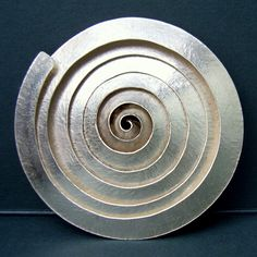 Spiral silver brooch | Contemporary Brooches by contemporary jewellery designer Debbie Long