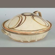 Michael Cardew a Wenford Bridge lidded Casserole Diameter 31cm (12 1/4in.). Bonhams.
