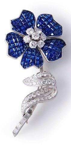 An Art Deco sapphire and diamond flower brooch, by Van Cleef & Arpels, Paris, circa 1937.