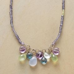 "COOL COLORS NECKLACE -- Anne Sportun collects cool-colored gems of amethyst, prehnite, London blue topaz, chalcedony and aquamarine. Peridot-sparked iolite strand with 18kt white gold. Handcrafted. Exclusive. 16""L."