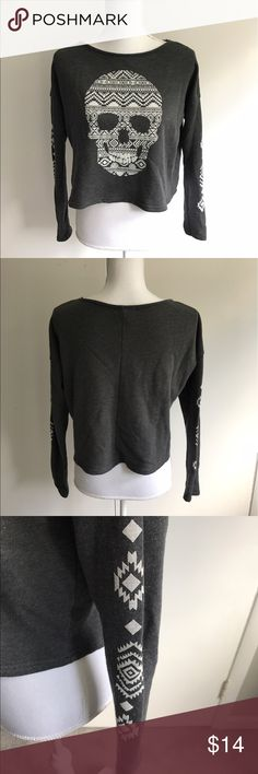Aeropostale crop long sleeve shirt Dark grey shirt with white skull on front and tribal graphic on sleeve. Item is used. Pit to pit 21 inches, shoulder to hem is 18 1/2 inches. Aeropostale Tops Crop Tops