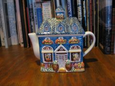 Front of a blue house teapot.  No markings.