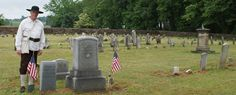A Muncy Historical Society volunteer portrays a Colonial soldier at the grave of Capt. John Brady.