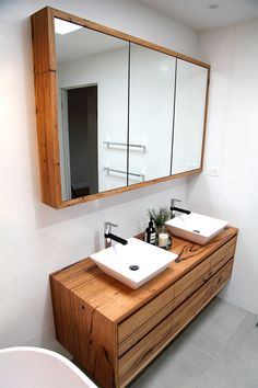 Matching timber bathroom vanity and shaving cabinet. This set has been designed and made to order to the clients specifications of size, configuration and timber preferences. Craftsman Bathroom, Bathroom Vanity, Kitchen Cabinets In Bathroom, Bathroom Interior, Timber Bathroom Vanities, Timber Vanity, Bathroom Design, Wooden Bathroom Cabinets, Bathroom