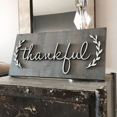 Thankful Sign approximately 8x16 in size. Stained a rustic grey. Individual laser cut letters with laurel wreath accent. Perfect for the holidays or even to keep up year round