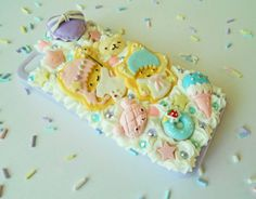 """One of a kind - iPhone 5/5s  Sweet Dream Decoden case.  Super sweet phone case has a  white """"whip cream"""" squishy background, that has been embellished with rhinestones,macarons and cabochons, in shades of lavender, baby blue and pink.  - This is a one-of-a-kind case - You WILL get the exact s..."""