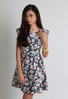Floral Cut-Out Dress. A pretty floral number with a girly charm and unique cut-out design at the back. Great piece to exude your femininity with a bit of sexiness! Available now at www.LaceAndButtons.com!