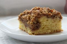 Cinnamon Cream Cheese Coffee Cake features a swirl of sweet cream cheese filling in a traditional coffee cake with a cinnamon-nut  crumb topping. - Bake or Break