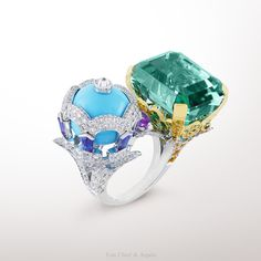 -Oiseaux Amoureux ring, Bals de Légende collection- White and yellow gold, round diamonds, yellow, pink and mauve sapphires, tsavorite garnets, one turquoise bead and one green emerald-cut tourmaline of 30.86 carats. The Oiseaux Amoureux ring from...