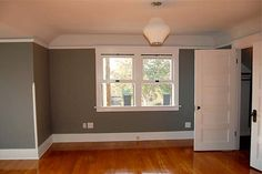 grey bedroom, wood floor, cove ceiling
