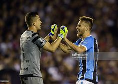 Brazil's Gremio goalkeeper Marcelo Grohe (L) and defender Bressan celebrate after teammate forward Luan scores the team's second goal against Argentina's Lanus during the Copa Libertadores 2017 final football match at Lanus stadium in Lanus, Buenos Aires, Argentina, on November 29, 2017. /