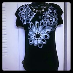 Black floral top Black top with floral print. Flare sleeves. Polyester and spandex blend provides stretch fit The Limited Tops