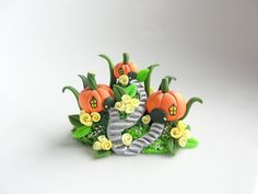 Miniature fairy pumpkin house village with yellow roses made from polymer clay by fizzyclaret