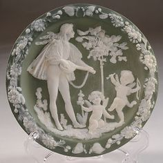 SOLD.......click through to see more vintage, antique and collectable items........Jasperware round plaque with mandolin player (music) and Psyche and Cupid. Cupid and Psyche also known as The Tale of Amour and Psyche or The Tale of Eros and Psyche.