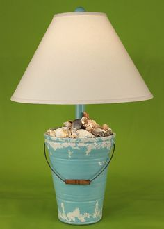 """Turquoise Distressed Beach Bucket Shell Lamp - these lamps are simply coastal cottage perfect!"" This might be nice if using a big solar lamp and a tin bucket full of rocks and such! Nautical Lamp Shades, Nautical Lamps, Nautical Table, Seaside Decor, Beach House Decor, Coastal Decor, Cottages By The Sea, Beach Cottages, Diy Luminaire"