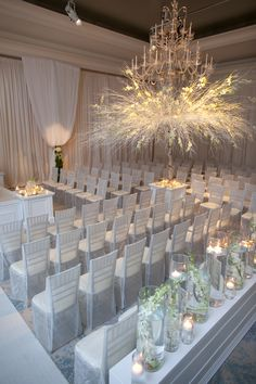 Submerged snapdragons and sheer seat covers compliment an extravagant centerpiece to create an all white masterpiece.
