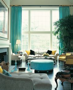Grey, turquoise, yellow, and white living room.... High curtains