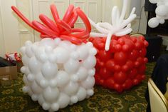 Balloon gift packages at our #burtonandburton employee award celebration.  #balloons #christmas
