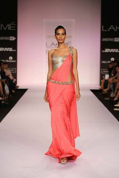 Jyotsna Tiwari Lakme Fashion Week Summer 2014 pink sari with gold blouse and belt. More here: http://www.indianweddingsite.com/jyotsna-tiwari-lakme-fashion-week-summer-resort-2014/