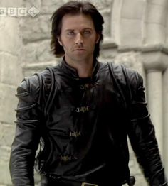 Guy of Gisborne. I love Richard Armitage!! He has a great accent) -- I simply love his deep voice. Which reminds me, I need to finish the 2nd half of Hamlet this morning.