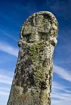 Located just outside of the Bodmin Moor village of Minions is Long Tom. The menhir is a   classic example of a Christianised stone.  Many of the Celtic crosses around Cornwall were  originally standing stones.  England  (Photo ©  Simon Crinks)