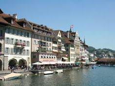 We stop in Schaffhausen to see the largest waterfalls in Europe, the RHINE FALLS, where in summer 600,000 liters of water falls down 23 meters (75 feet) every second.    We continue to LUCERNE, this most beautiful city at the foot of the Swiss Alps on fabulous Lake Lucerne. See the Lion Monument (the famous dying Lion of Lucerne), walk the wooden Chapel Bridge and join your guide for a stroll of the old town.