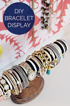 This chic bracelet holder is actually a dolled-up paper towel tube.