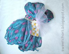 A Sweet Gift Idea...  Give a scarf with a matching bracelet around it.