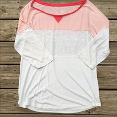 "Color blocked American Eagle tee ""featherlight"" In excellent condition with no rips or stains. I'm not sure if this has ever been worn. Coral, peach, and cream colored. 3/4 sleeves. Lightweight. Armpit to armpit is 22 inches across. Thanks for looking. American Eagle Outfitters Tops Tees - Long Sleeve"