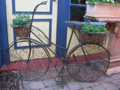Your old bike might not be quite so ornate but many bikes still have baskets or could have one attached.  Get creative!  | The Micro Gardener www.themicrogardener.com