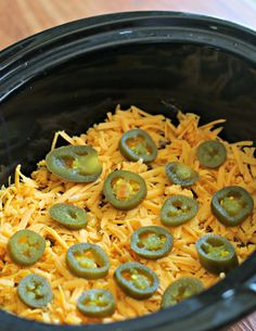 #Crockpot 7-Layer Mexican Dip recipe (refried beans, ground beef, sour cream, salsa, cheese, jalapenos, green onion)