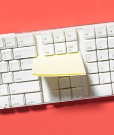 Sticky Note as Keyboard Cleaner-slide the adhesive strip of a sticky note through the crevices to collect and lift out dust and debris. Tomorrow...at work...oh yeah