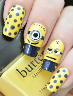 Minions Mani      Butter London 'Cheeky Chops' (3 coats) base colour     Avon Suede effect polish 'Blue Royale' Dots and dungarees     Black and white acrylic paint     jump rings