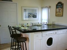 washer and dryer in island of kitchen