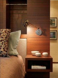 bedside table--bowls for jewellery, shelving below for books, built in to headboard