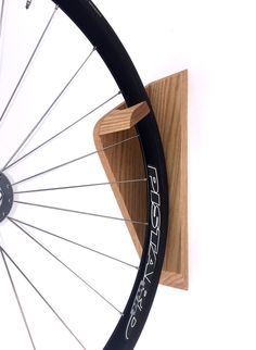 A simple yet elegant way to store your bike vertically. Sleek and clean design that blends well into any interior without the appearance of a cheap metal hook. Handmade in New York and available in oa