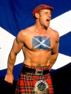 hot man in a kilt and sporan also sporting the scottish flag. the highlands are calling...