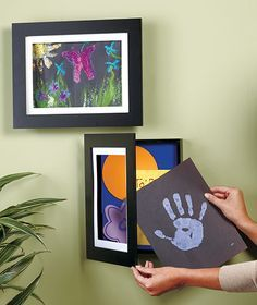 """sized to hold the standard sizes of artwork created at school or home, 8-1/2"""" x 11"""" or 9"""" x 12"""". It's easy to change the artwork—just open the door and slide the new picture into the front pocket. Each polystyrene-covered wooden frame also includes a 3/4"""" deep compartment behind the picture to store approx. 50 more pictures. $9 - $10"""