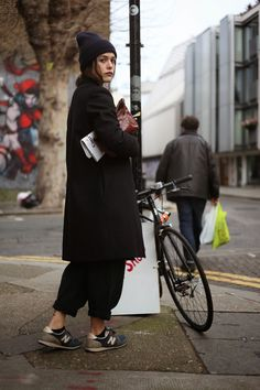 The woman in black with long jacket and sporty shoes. http://believeinmystyle.weebly.com/fashion.html