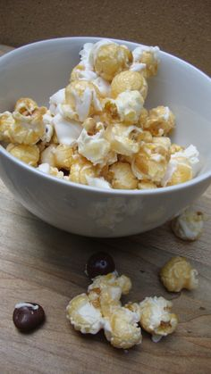 Carmel and frosting covered popcorn with chocolate covered blueberries! Yum!